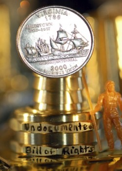 Trophy with Coin affixed and miniature man standing to side