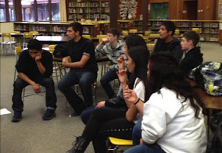 Figure 2. High school Latina/o Culture Club members enjoy some dulce while recollecting their days in a dual language elementary school.