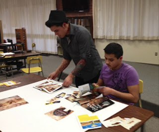 Figure 3. Salish High School student works on his culture poster board with an undergraduate mentor from The Evergreen State College.
