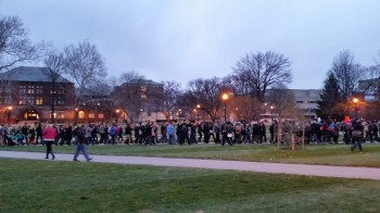 marchers with signs and placards on OSU oval