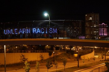 letters spelling out Unlearn Racism