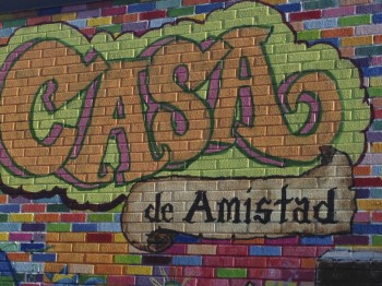 coloral mural on wall with name of center Casa de Amistad