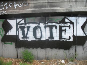 "Word ""vote"" painted on fence"