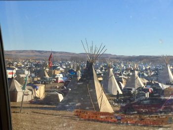 tents, shelters, and teepees across plains